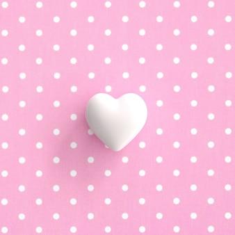 Corazón blanco sobre fondo rosa pokadot. idea de concepto de san valentín mínima.
