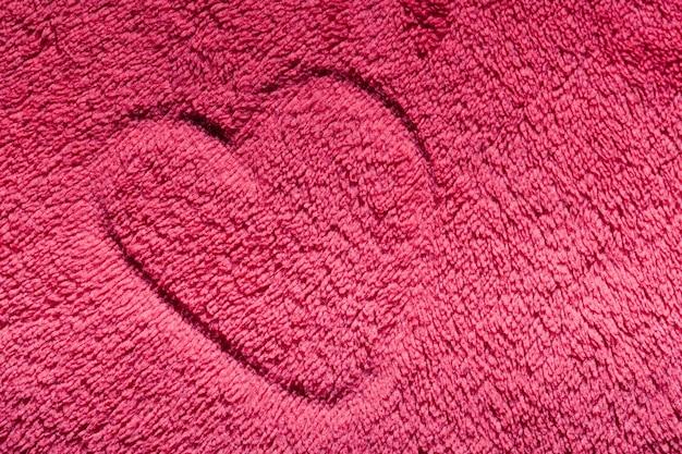 Corazón dibujado en alfombra