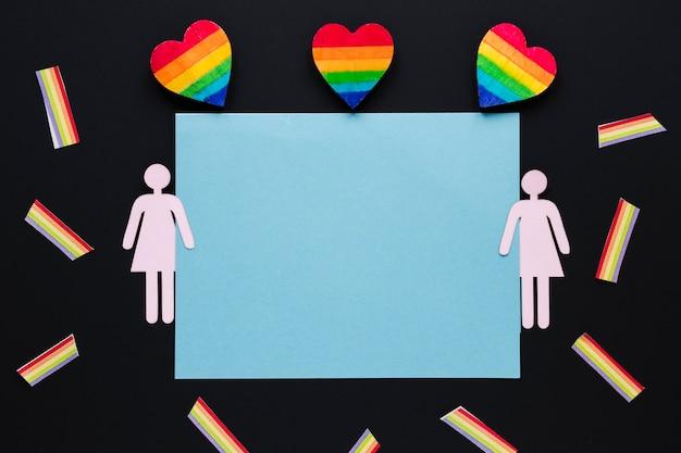 Corazones de arco iris con icono de pareja de lesbianas y papel