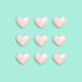Corazones de papel rosa