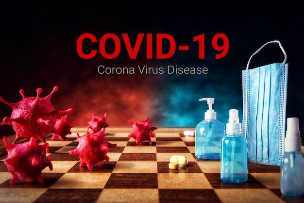 (covid-19) máscara quirúrgica de batalla contra la enfermedad del coronavirus y gel desinfectante para manos con alcohol para la protección contra la propagación de la higiene en el tablero de ajedrez