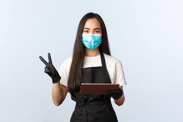 Covid-19, pedidos en línea, pequeñas cafeterías y concepto de prevención de virus.
