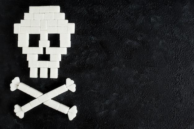 El cráneo hecho de cubos de azúcar. el azúcar mata.