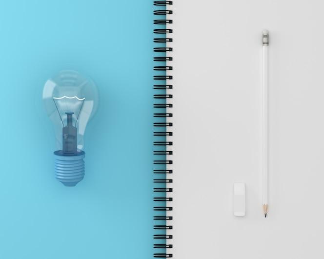 Creativo de la bombilla con lápiz blanco en la página del cuaderno blanco y azul.