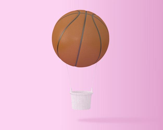 Creativo del globo grande del aire caliente del baloncesto en fondo rosado. concepto de deporte minimalista.