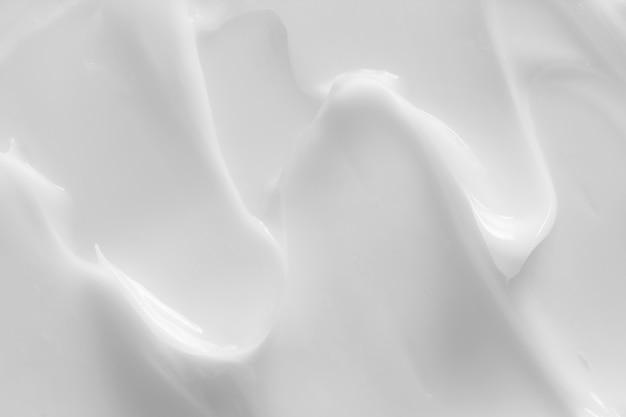 Crema cosmética, loción, crema hidratante, textura cremosa del producto para el cuidado de la piel