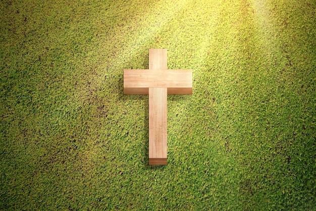 Cruz cristiana sobre la verde hierba