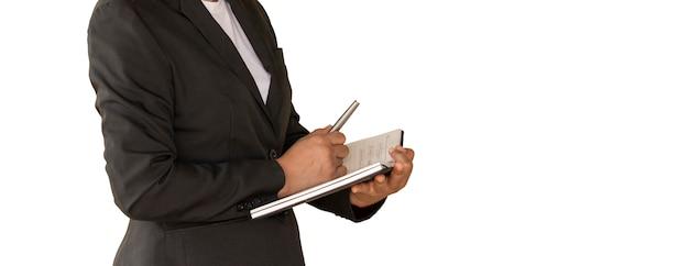 Cuaderno de la explotación agrícola de la mujer de negocios aislado en blanco.