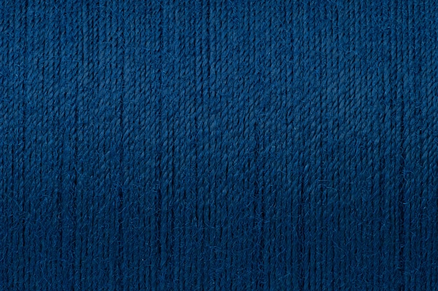 Cuadro macro del fondo azul marino de la textura del hilo