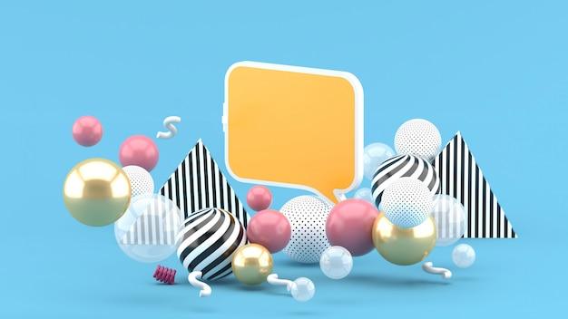 Un cuadro de texto entre bolas de colores en un espacio azul