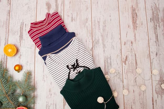 Cuatro suéteres. concepto de moda.