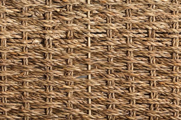 Cuerdas trenzadas de esparto formando una superficie plana para diferentes usos. las cuerdas de hierba de esparto se utilizan para la artesanía tradicional mediterránea.
