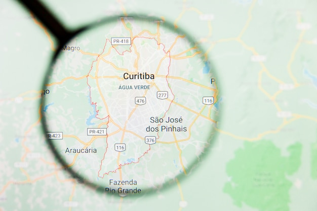 Curitiba, brasil ciudad visualización concepto ilustrativo en pantalla a través de lupa