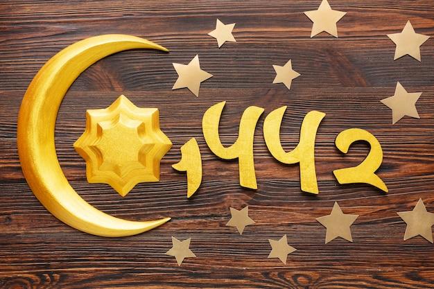 Decoración de año nuevo islámico con símbolo de estrella y luna