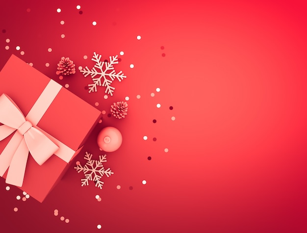 Decoración navideña con caja de regalo, bola, piña, confeti y copos de nieve.