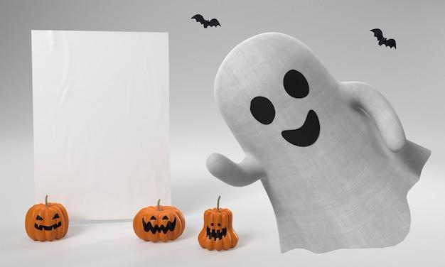 Decoraciones de halloween con fantasmas y calabazas.