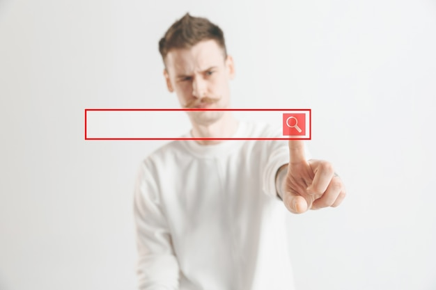 El dedo del empresario tocando la barra de búsqueda vacía, concepto de fondo empresarial moderno - se puede utilizar para insertar texto o imágenes.