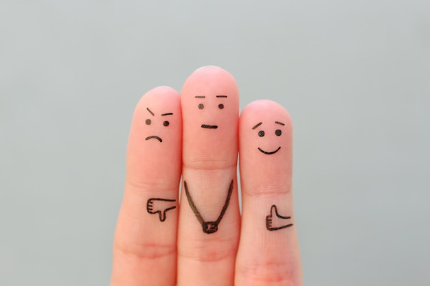Los dedos del arte de las personas. concepto de emociones positivas y negativas.
