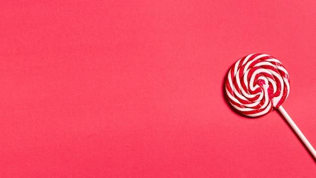 Delicioso bastón de caramelo con espacio de copia