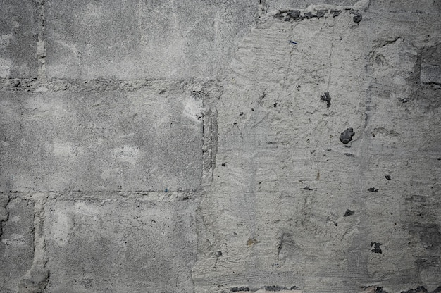 Demoler la textura de la pared de hormigón agrietado