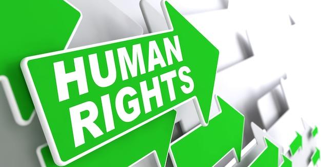 Derechos humanos. flechas verdes con lema sobre un fondo gris indican la dirección.