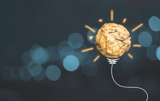 Deseche la bola de papel amarilla con la luz brillante del dibujo y el arnés de cables.