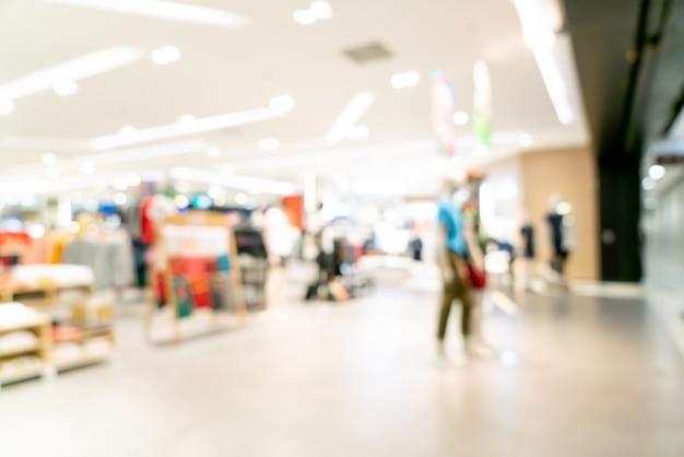 Desenfoque abstracto y centro comercial desenfocado o interior de grandes almacenes