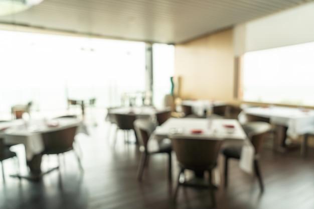 Desenfoque abstracto y desayuno buffet desenfocado en el interior del restaurante del hotel como fondo borroso
