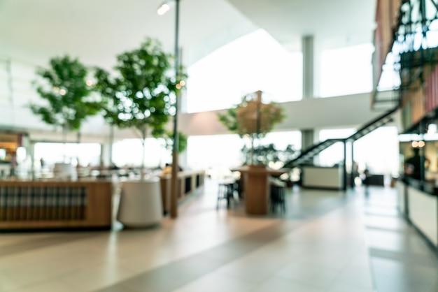 Desenfoque abstracto y desenfocado food court center en el centro comercial