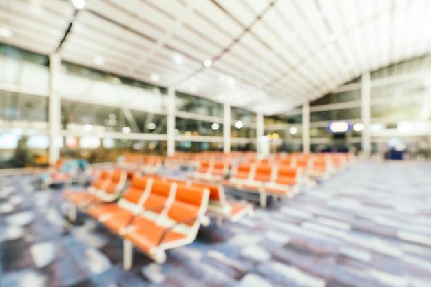 Desenfoque abstracto y interior de la terminal del aeropuerto desenfocado, fondo borroso de la foto