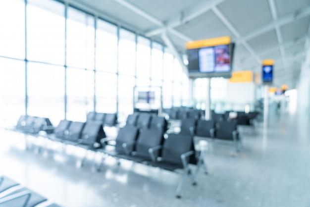 Desenfoque abstracto y interior de la terminal del aeropuerto desenfocado