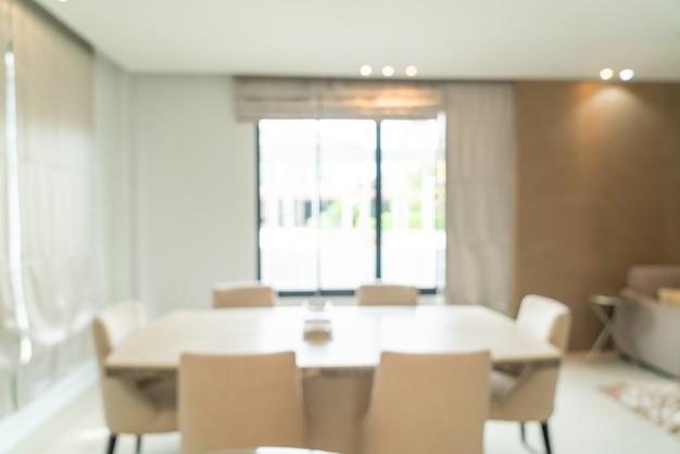 Desenfoque abstracto y mesa de comedor desenfocada en el comedor para