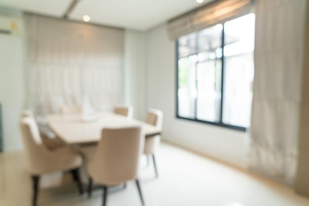 Desenfoque abstracto y mesa de comedor desenfocada en el comedor