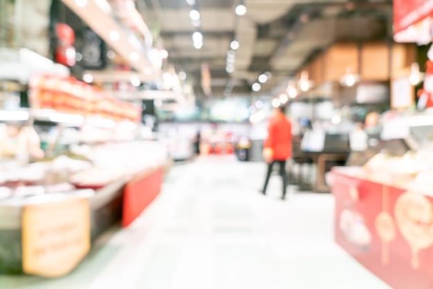 Desenfoque abstracto y supermercado desenfocado para el fondo