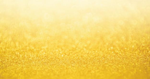 Desenfoque de fondo de textura festiva brillo oro abstracto con luz bokeh