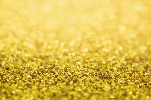 Desenfoque de fondo de textura de navidad festiva brillo dorado abstracto con luz bokeh