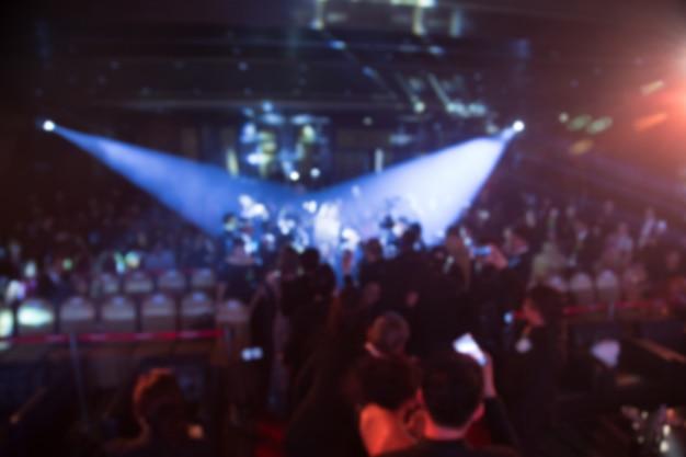 Desenfoque del tema de la ceremonia de premiación creativa con iluminación hacia abajo. fondo para el concepto de negocio