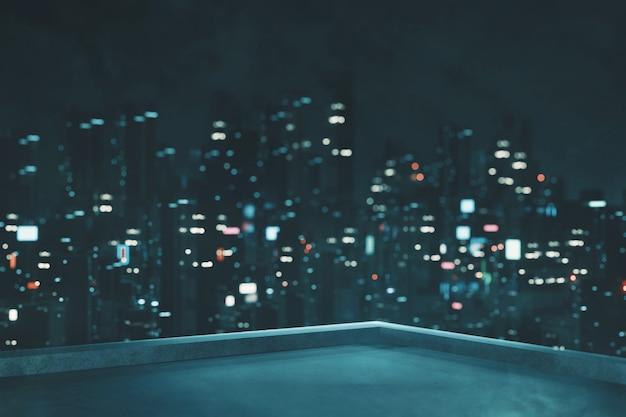 Desenfoque de vista de la ciudad por la noche desde la azotea del edificio