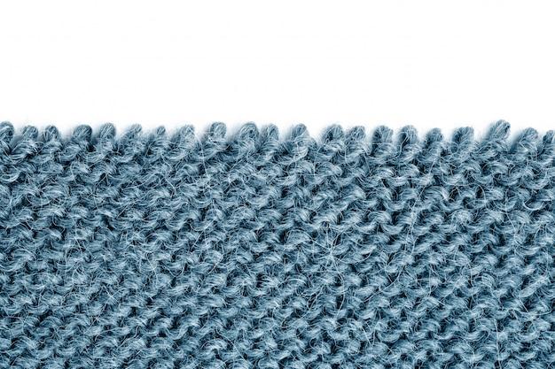 Desentrañar tejido de punto en blanco