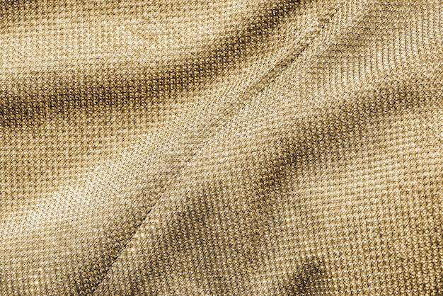 Desordenado fondo de tela dorada