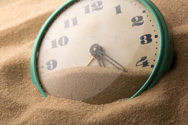 Despertador en arena