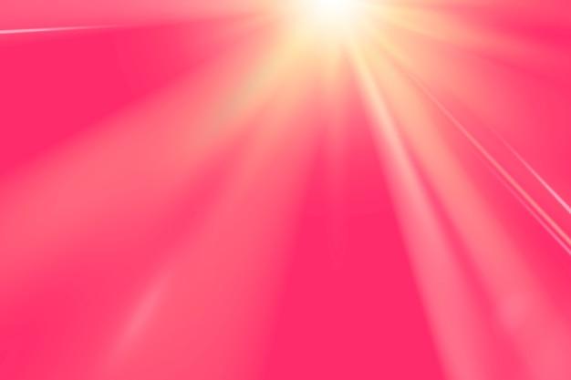 Destello de lente de luz dorada sobre fondo rosa vivo
