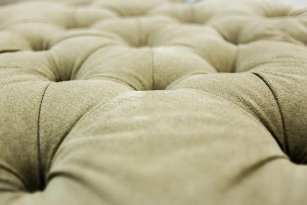 Detalle de fondo de textura de sofá de acabado de botón