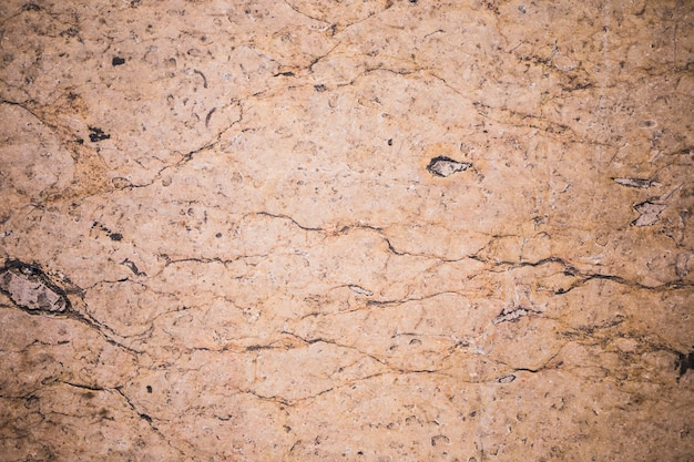 Detalle de muro de mármol marrón