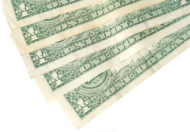 Detrás de un fondo de billetes de un dólar