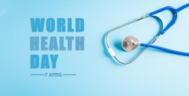 Día mundial de la salud con estetoscopio médico sobre superficie azul pastel