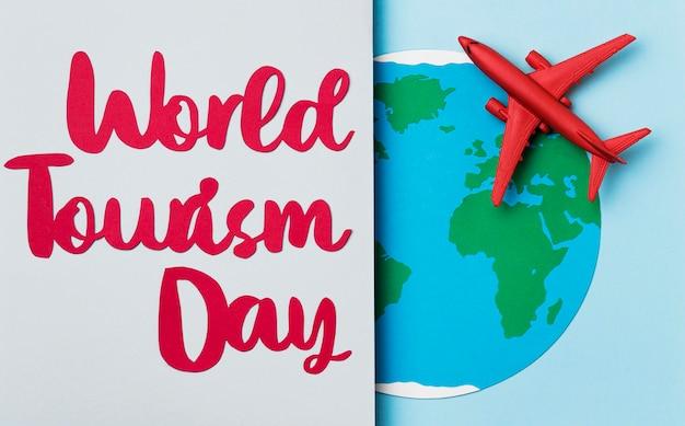 Día mundial del turismo con concepto de letras