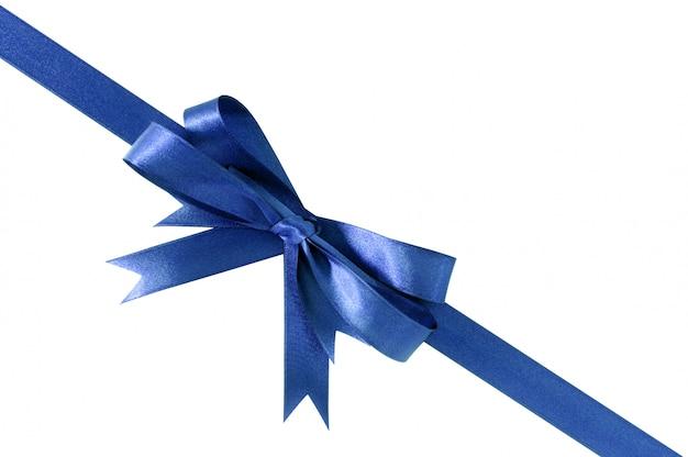 Diagonal azul real profunda de la esquina del arco de la cinta del regalo aislada en blanco.