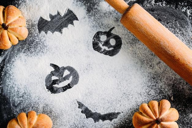Dibujo de calabaza de halloween cabeza linterna y murciélago sobre fondo de harina de trigo