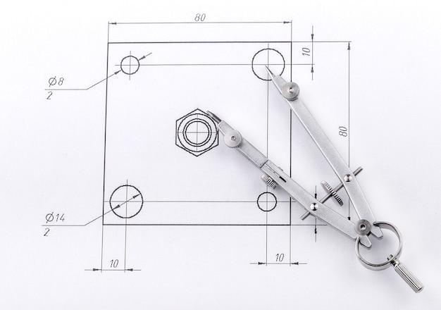 Dibujo de ingeniería y separadores de metal.